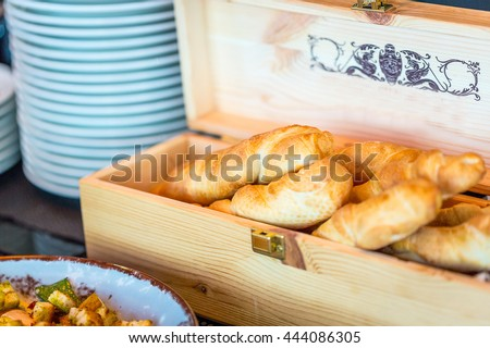 Fresh Tasty Whole Wheat Bread Buns in Wooden Old Rustic Box from Wine, Organic, Homemade Food, Brunch Time in Restaurant, Close-up - stock photo