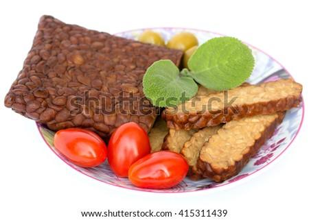 Fresh tempeh on a saucer - stock photo