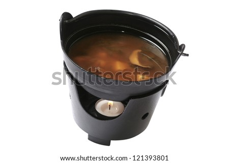 fresh thick miso soup in a black bowl on a white background