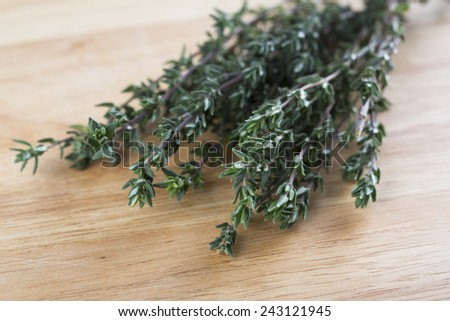 Fresh Thyme on wooden board. - stock photo