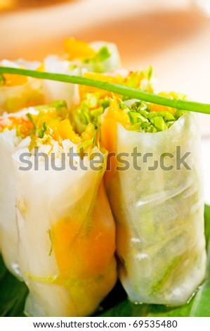 fresh tipycal vietnamese style summer rolls,on a palm leaf - stock photo