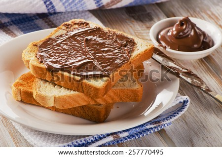 Fresh Toast with chocolate spread on a white plate. - stock photo