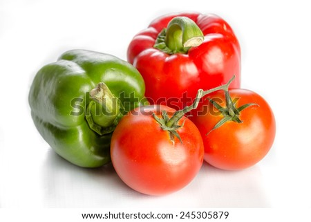 fresh tomato and bell pepper on white background - stock photo