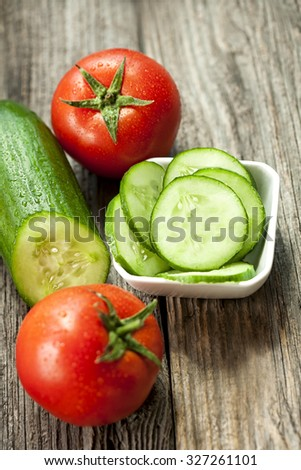 Fresh tomato and cucumber - stock photo