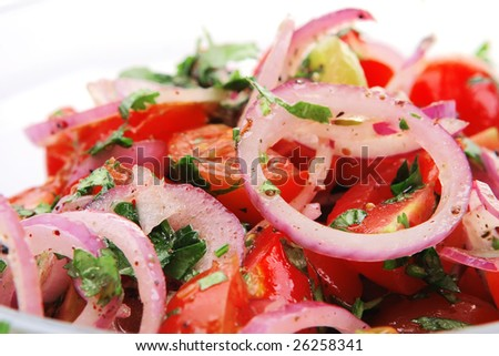 fresh tomato and onion salad inside transparent bowl