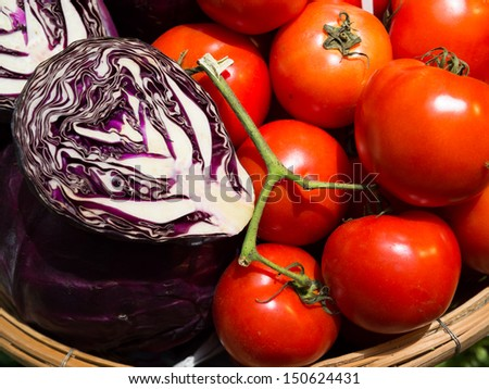 Fresh Tomato and Red cabbage - stock photo