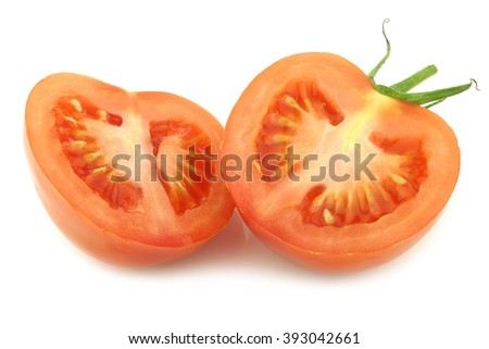 fresh tomato halves on the vine on a white background - stock photo