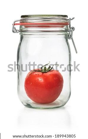 Fresh tomato in a canning jar - stock photo