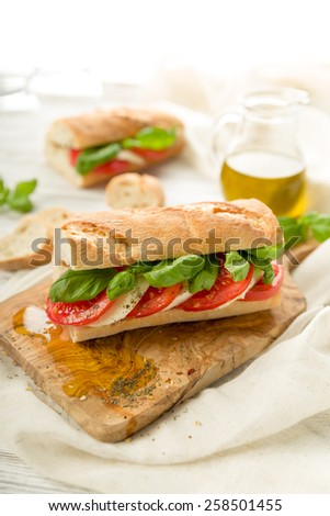 Fresh tomato mozzarella baguette with fresh basil