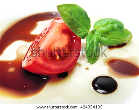 fresh tomato slice with oil and balsamic vinegar.    - stock photo