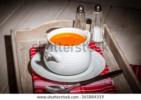 Fresh tomato soup in a white bowl. Selective focus.