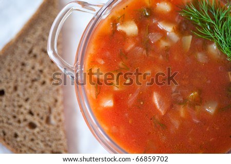 Fresh tomato soup in bowl close up. Minestrone - stock photo