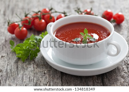 fresh tomato soup with basil - stock photo