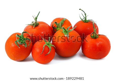 Fresh tomato vegetables pile isolated on white background cutout