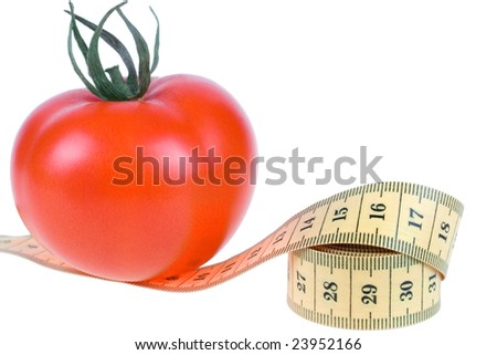 fresh Tomato with measuring tape on white background