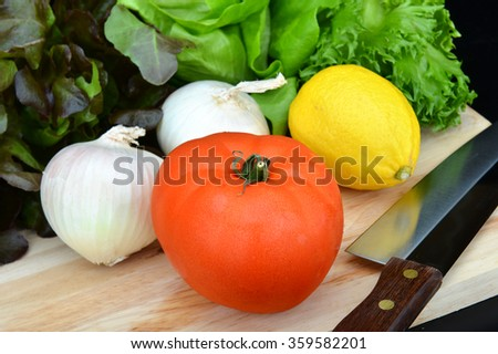fresh tomato with vegetable onion lemon ready for cooking