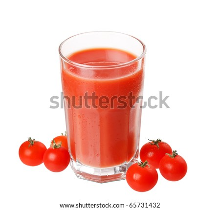 Fresh tomatoes and a glass full of tomato juice - stock photo