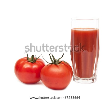 Fresh tomatoes and a glass full of tomato juice on white - stock photo