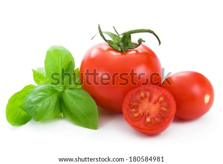 Fresh tomatoes and basil - stock photo