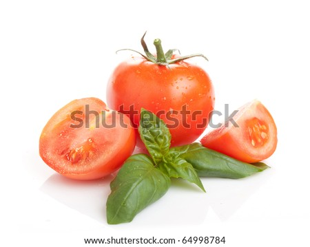 Fresh tomatoes and basil leaves on white background - stock photo