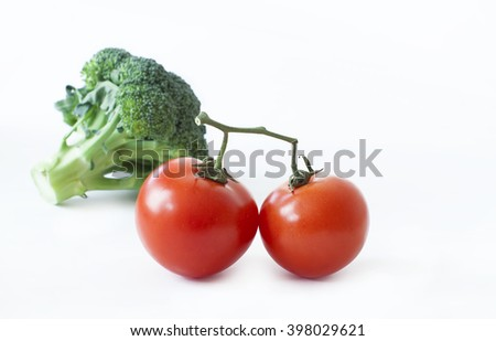 fresh tomatoes and broccoli isolated on white background - stock photo