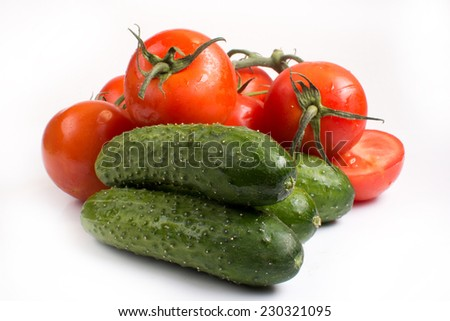 fresh tomatoes and cucumbers on a white background