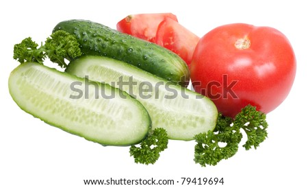fresh tomatoes and cucumbers with greenage isolated on white background