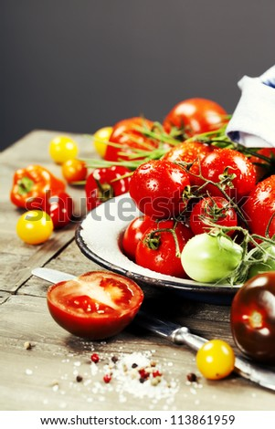 fresh tomatoes and herbs on a wooden table