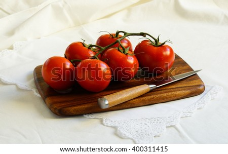 fresh tomatoes branch on the white background