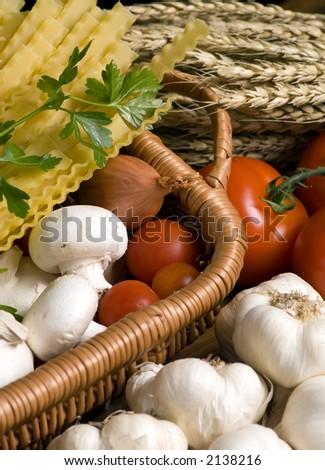 Fresh tomatoes, garlic, onions and mushrooms await preparation for great Italian pasta. - stock photo