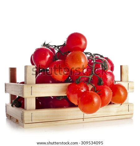 fresh tomatoes in a wooden crate isolate on a white background - stock photo