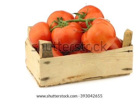 fresh tomatoes in a wooden crate on a white background - stock photo