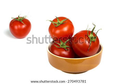 Fresh tomatoes in one brown bowl isolated over white background - stock photo