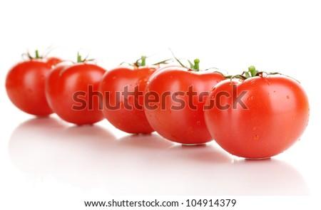 Fresh tomatoes isolated on white - stock photo