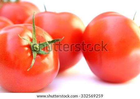 fresh tomatoes isolated on white. - stock photo
