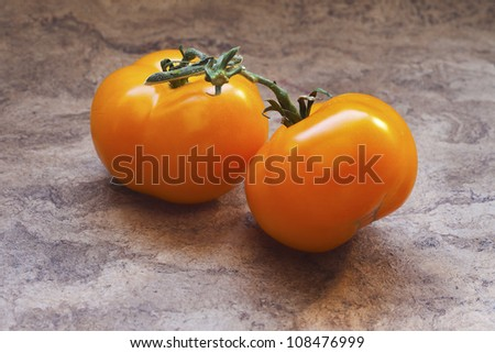 Fresh tomatoes on a table.