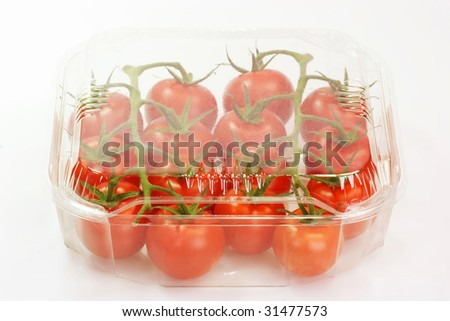 Fresh tomatoes on bright background