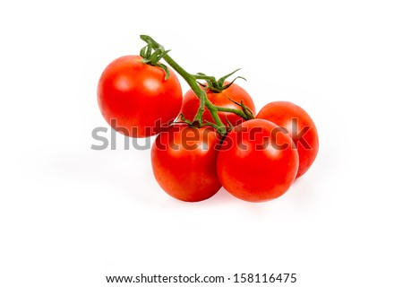 Fresh tomatoes on the vine isolated on white background