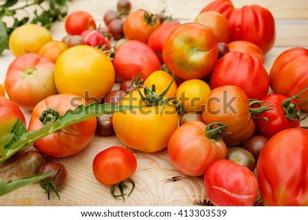 Fresh tomatoes on the wooden table. Village mess.