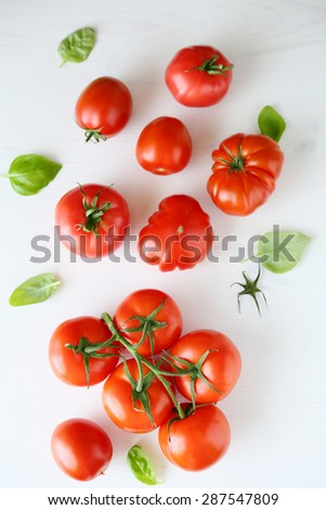 fresh tomatoes on white wooden background, top view - stock photo