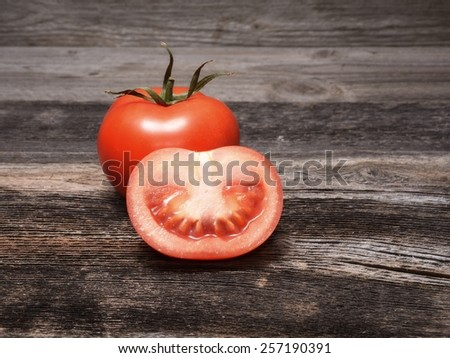 Fresh tomatoes on wooden background - stock photo
