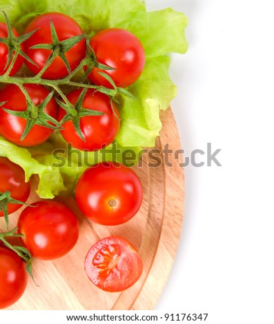 fresh tomatoes on wooden board - stock photo