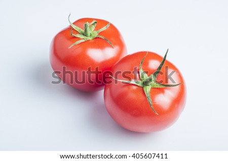 Fresh tomatoes over white background - stock photo