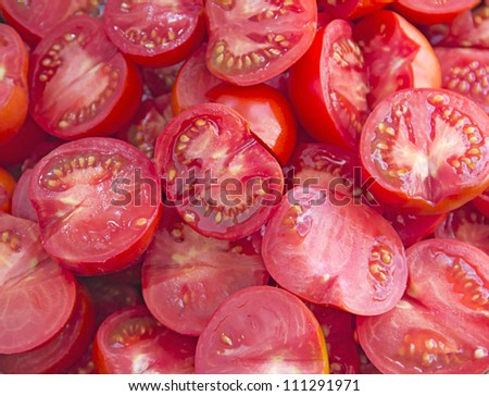 Fresh tomatoes slices background