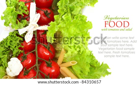 Fresh tomatoes wrapped with green leaves of lettuce salad isolated on white background