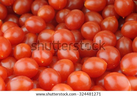 fresh Tomberry (very small) tomatoes background - stock photo