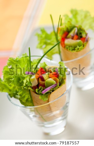 fresh  tortilla wraps with vegetables in glasses - stock photo