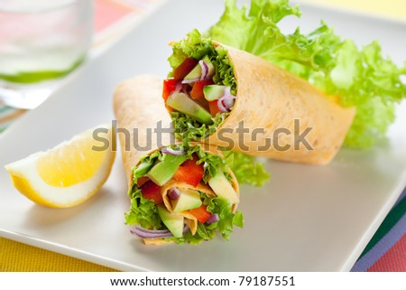 fresh  tortilla wraps with vegetables on the plate - stock photo