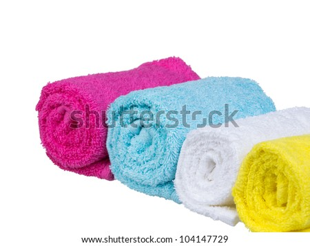 Fresh towels rolled-up general view on white background - stock photo
