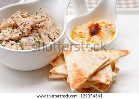 fresh traditional arab chicken taboulii couscous with hummus - stock photo